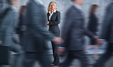 A business lady struggling with the fear of herd mentality
