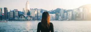 Young woman overlooking Hong Kong Victoria Harbour