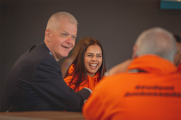 University of Sunderland's Vice-Chancellor and Chief Executive Sir David Bell chatting happily with students and staffer