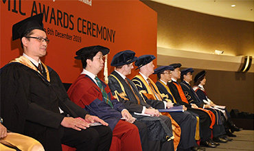 Guests on stage for University of Sunderland in Hong Kong's graduation ceremony 2019